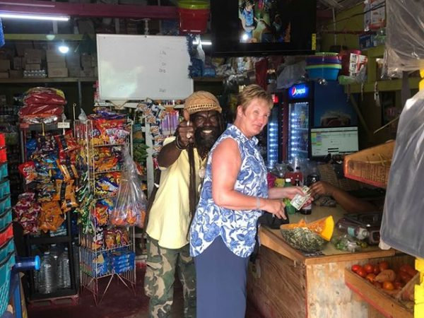 Guest and guide in food shop Jamaica