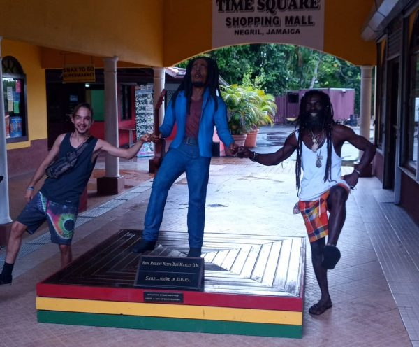 guests and guide fun in shopping mall with Bob Marley statute